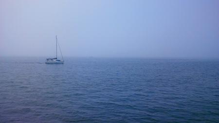 Sailboat in Blue Waters