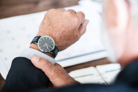 Selective Focus Photo of a Person Wearing Round Watch at 9:36