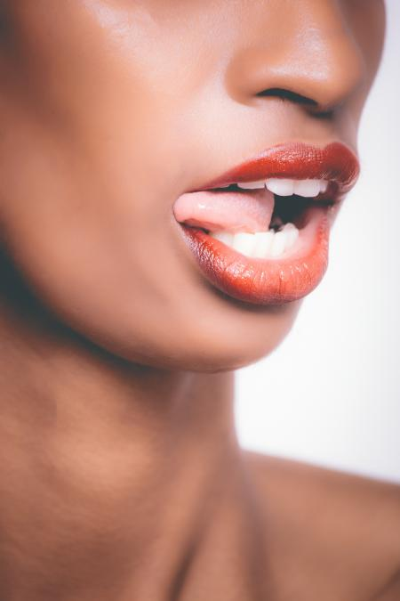 Selective Focus Photograph of Woman Sticking Her Tongue Out