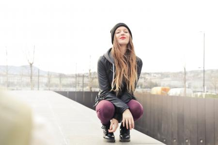 Selective Photo of Woman in Gray Hooded Jacket Doing Crouch Position