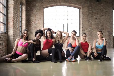 Seven Women Sitting on Floor
