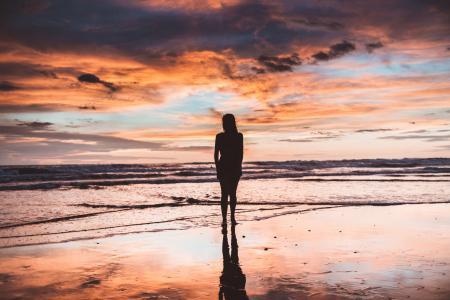Silhouette of Woman Near Sea Shore