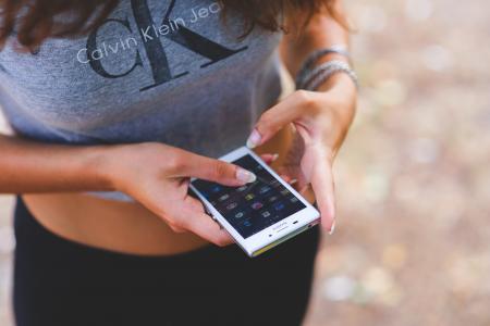 Smartphone in girl's hands