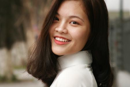 Smiling Woman Wearing White Turtleneck Top