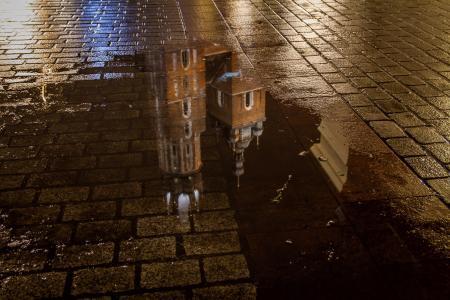 St Mary's Basilica (Kościół Mariacki) reflection in a puddle, Krakow, Poland