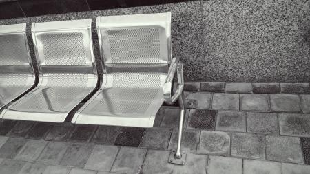Stainless Steel Bench on Top of Gray Pavement
