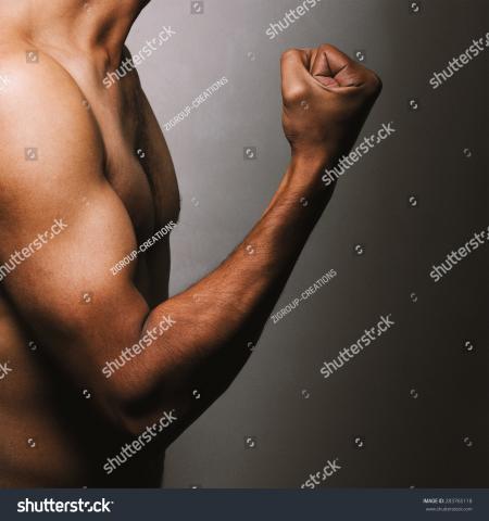 Standing shirtless, closeup
