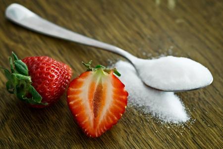 Strawberry Beside Spoon of Sugar