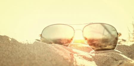 Sunglasses on the Sand at Sunse