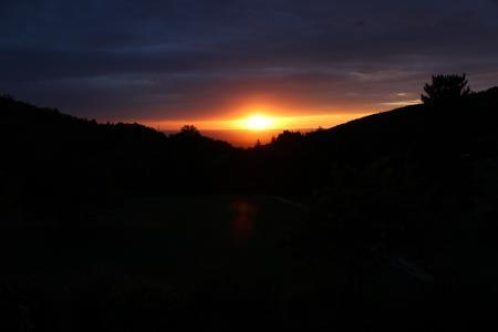 Sunset between clouds