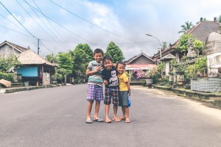 Three Boys Standing on Road