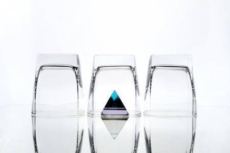 Three glasses and a pyramid