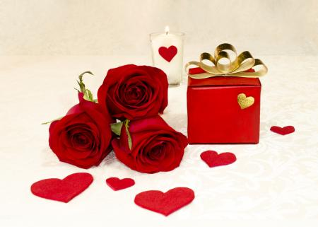Three red roses and a gift