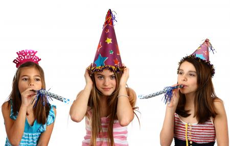 Three young girls celebrating a birthday