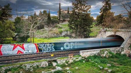 Time Lapse Photography of Train Passing Through Bridge