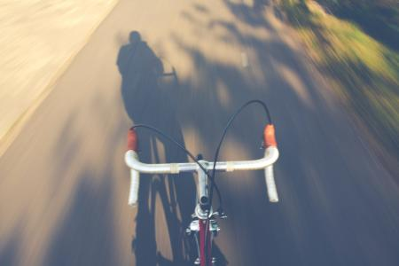 Timelapse Photography of a Person Riding a Road Bike