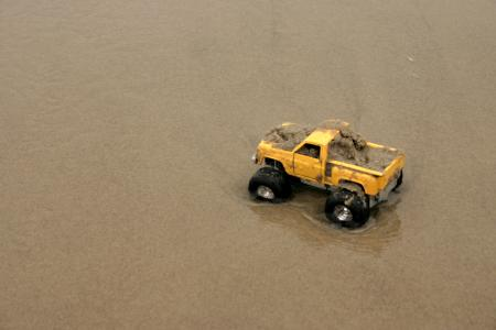 Toy car in sand