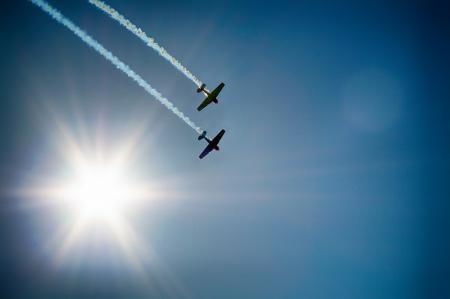 Two Airplane Flying Under Blue Sky Emitting White Smoke