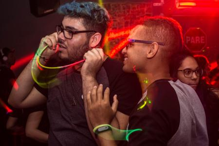 Two Man Wearing Eyeglasses Standing Under Red Led Light
