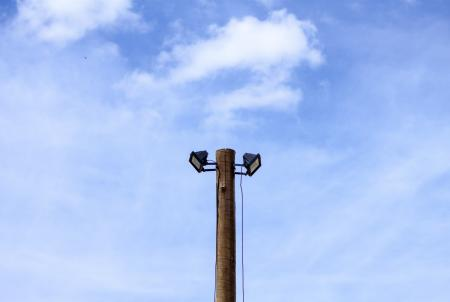 Two spotlights atop a wooden post