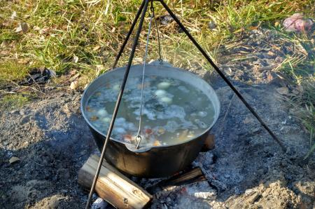 Ukha (fish-soup) cooked with wood ear in a cauldron