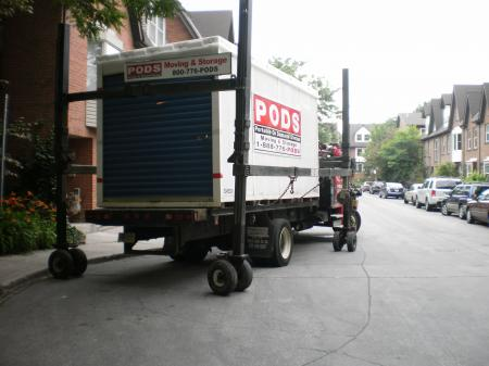 Unloading a shipping container with household contents -c