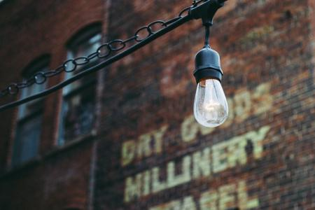 Urban lamp on a brick wall background