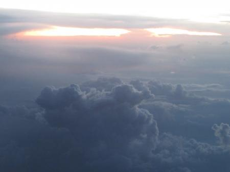 View of the cloudy sky from the plane