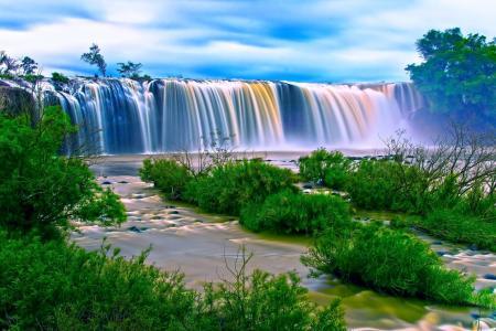 Water Falls Surrounding Green Grass during Daytime