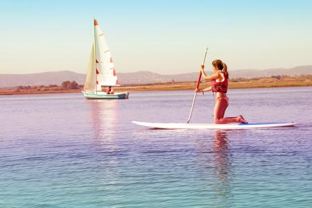 Watersports - Girl Practicing on Paddle Board