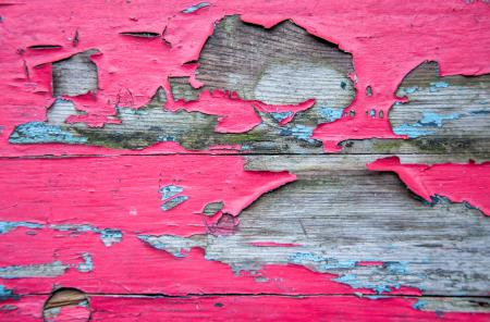 Weathered and peeling paint on wood