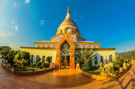 White Buddhist Temple With Blue Cloudy Background