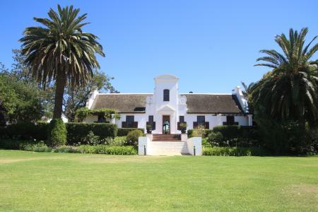 White mansion in the garden