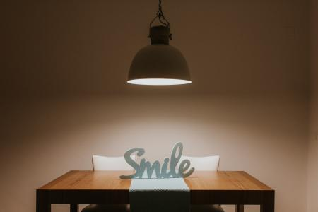 White Smile Cutout Signage on Table