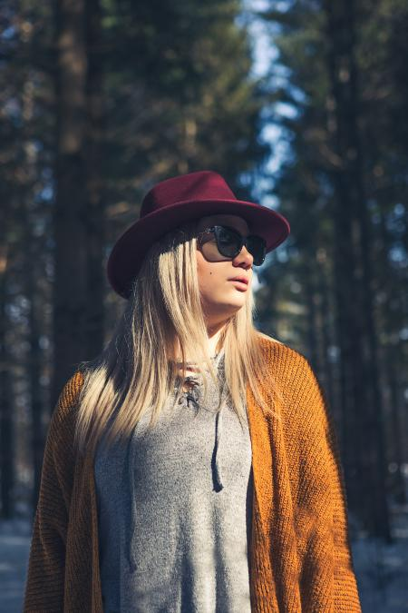 Woman in Brown Cardigan and Gray Top Near Green Leaf Trees at Daytime