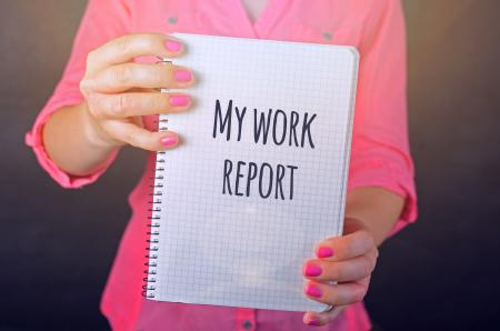 Woman in Pink Long-sleeved Shirt Holding White Book With My Work Report Text Print