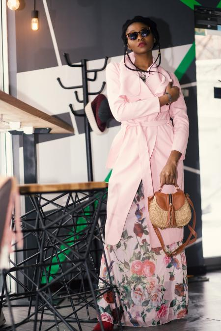Woman in Pink Robe Holding Brown Leather 2-way Handbag