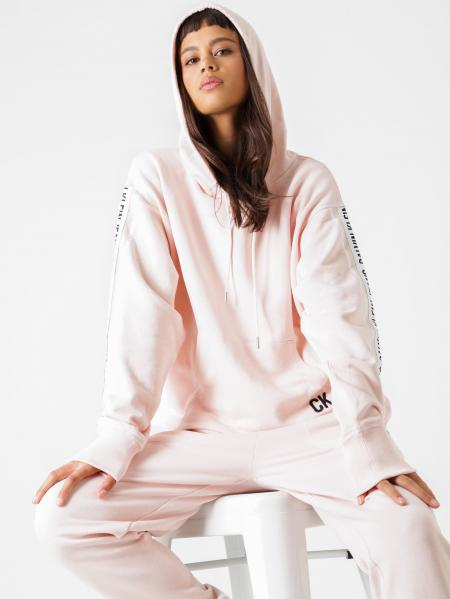Woman In Pink Sweatshirt Siting On White