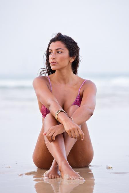 Woman in Purple Bikini Sitting on Shore