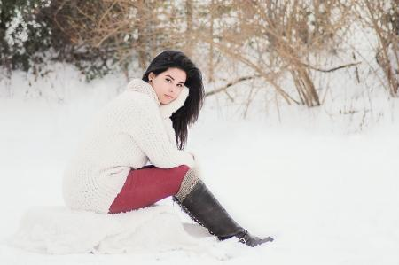 Woman In White Sweater Sitting Near Grass During Winter Season