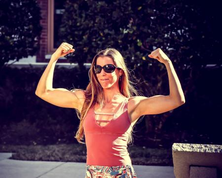 Woman Showing Muscles