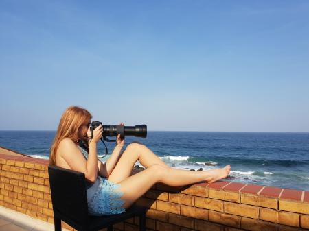 Woman Sitting Holding Dslr Camera