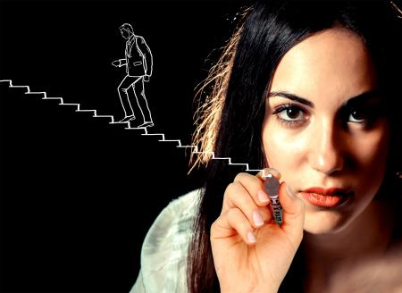 Woman sketching a businessman climbing stairs