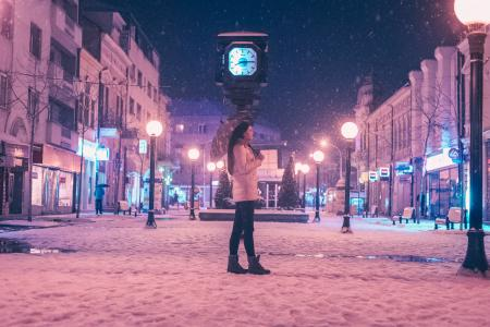 Woman Walking on Street Near Light Post during Winter Season