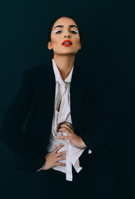 Woman Wearing Black Formal Suit Jacket Doing Pose