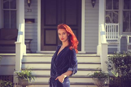 Woman Wearing Black Jumpsuit Standing Near the House