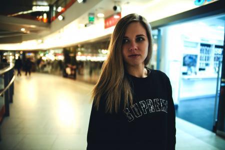 Woman Wearing Black Supreme Sweater