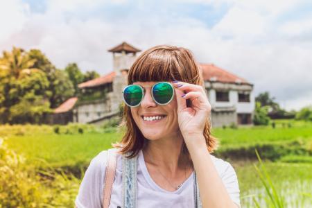 Woman Wearing Green Sunglasses