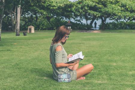 Woman Wearing Green Top Reading Book