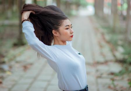 Woman Wearing Grey Crew Neck Long Sleeve Shirt